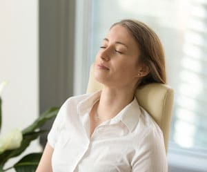 woman relaxing in present moment with mindfulness session