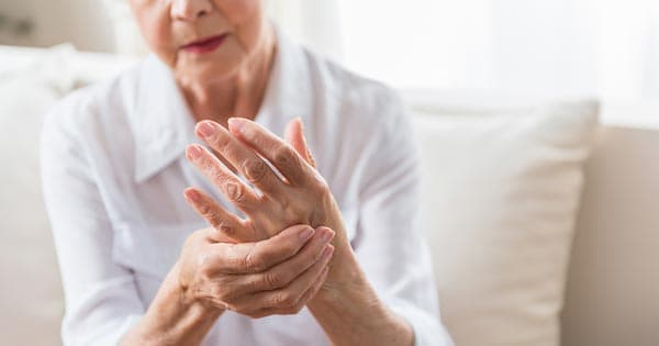 arthritis pain in hand for senior woman