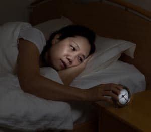 Woman having Restless Sleep Image