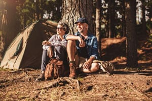 senior couple camping forest