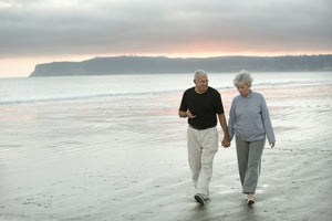 Senior Couple Walking the Beach Image