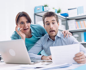 Couple stressing over debt and bills
