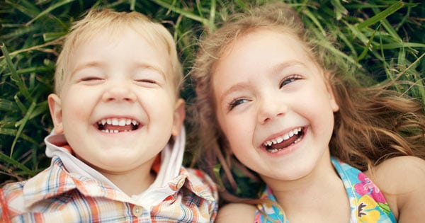 Brother and Sister Laughing on ground