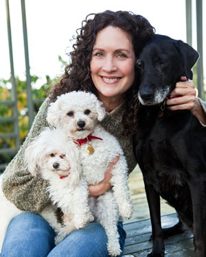 Happy woman and her dogs