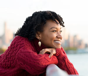 happy smiling woman thinking positive thoughts
