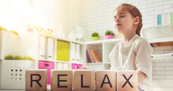 young child relaxing eyes closed