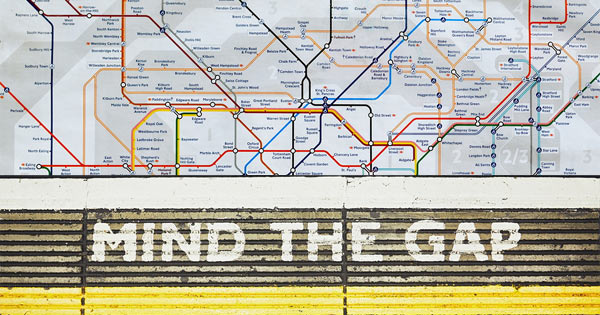 Mind the Gap sign over London underground map