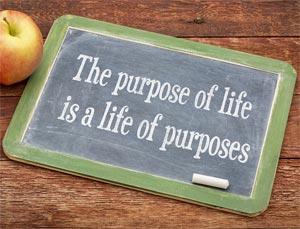 Life of purposes saying written on chalkboard