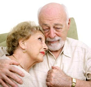 Older couple grieving together after a loss of loved one
