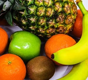 Various healthy fruits on table