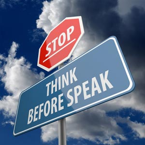 Stop sign saying underneath think before speak