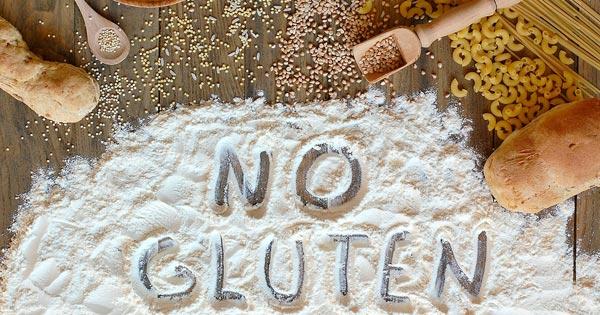Gluten free goods and grains with words no gluten written in white flour