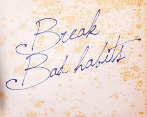 Break bad habits handwriting on sheet of paper
