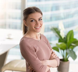 Smiling confident young woman in business setting