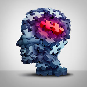 Psychology and head showing puzzle pieces
