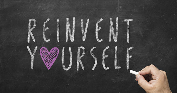 Reinvent yourself handwriting on chalkboard