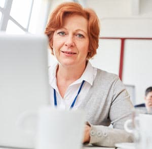 Senior woman on computer doing training