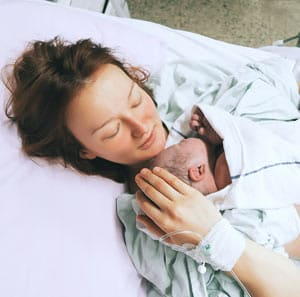 Mother holding baby few seconds after birth