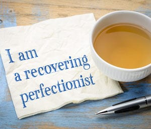 Recovering perfectionist written on a napkin