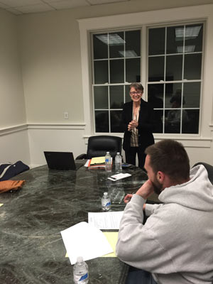 Image showing Erika Slater leading a group class in conference room