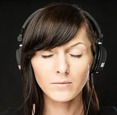 Girl listening to music or self-hypnosis session on her player