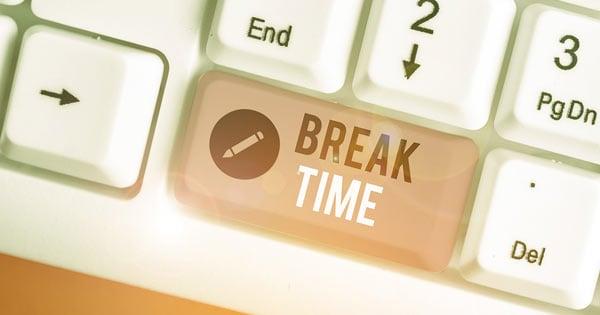 Computer keyboard showing break time on key