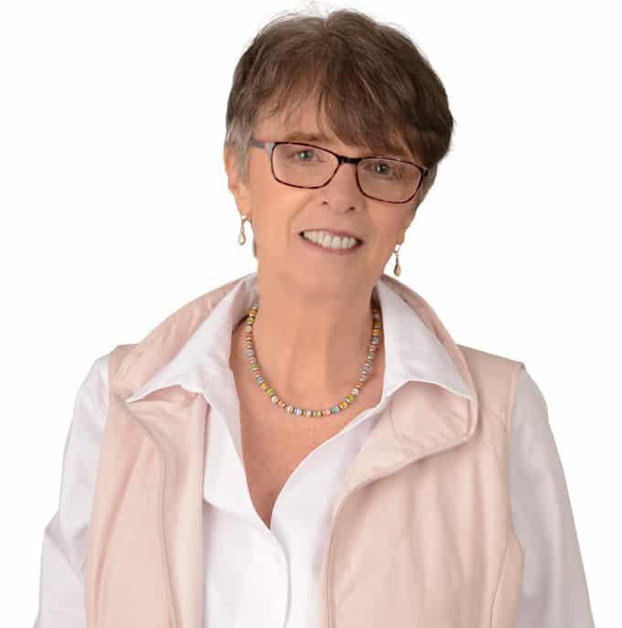 Image pf Erika Slater on white shirt and sleeveless jacket