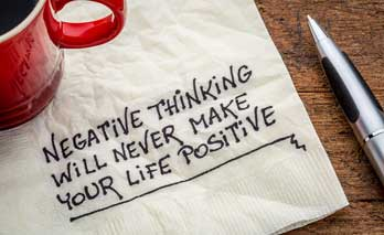 Image of napkin showing writing on it about negative thinking will never make your life positive