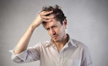 Image showing adult male looking concerned with one hand on his head