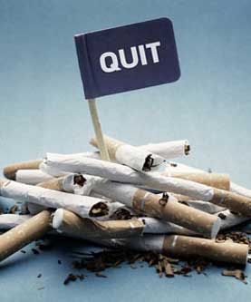 Image of pile of cigarettes with Quit Flag in middle